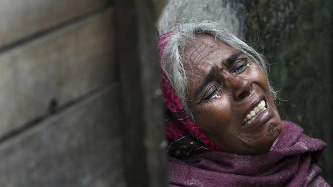 The mother of Ram Singh, the man accused of driving the bus on which a 23-year-old student was gang raped in December 2012, cries as she speaks to journalists outside the family's home in New Delhi, India, Monday, March 11, 2013. Indian police confirmed that Ram Singh, one of the men on trial for his alleged involvement in the gang rape and fatal beating of a woman aboard a New Delhi bus committed suicide in an Indian jail Monday, but his lawyer and family allege he was killed. (AP Photo/Manish Swarup) INDIA OUT