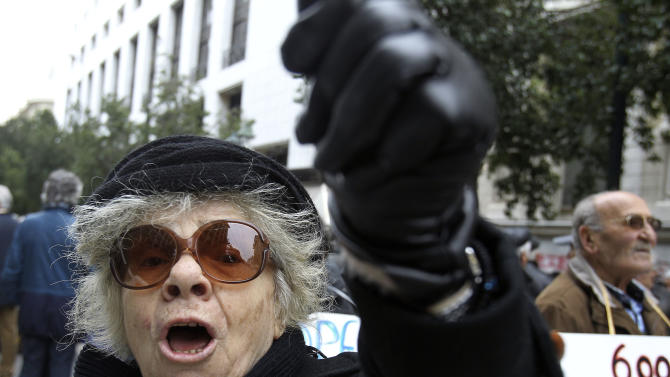 A pensioner shouts slogans during a protest against the Greek government's planned pension cut, outside Labor Ministry in Athens, on Tuesday, Feb. 14, 2012. The struggling eurozone country has been shut out of long-term debt markets since 2010, and is surviving on rescue loans from European Union countries and the International Monetary Fund. But harsh austerity measures demanded in return for the emergency loans have hammered the economy. (AP Photo/Thanassis Stavrakis)