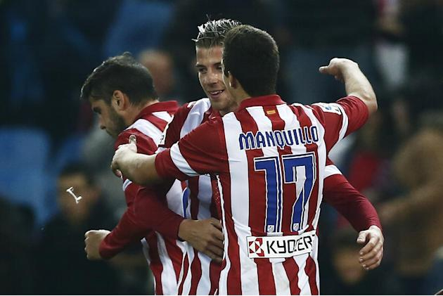 Atletico's Atletico's Toby Alderweireld, center, celebrates his goal with team mates during a Copa del Rey soccer match between Atletico de Madrid and Sant Andreu at the Vicente Calderon stadi