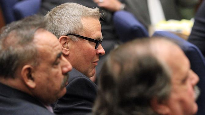 George Cole, center,a former Bell City Council member listen to judge as a guilty verdict is read in his trial on Wednesday, March 20, 2013, in Los Angeles.  Cole and four former elected officials Bell were convicted of multiple counts of misappropriation of public funds, and a sixth defendant was cleared entirely. Former Mayor Oscar Hernandez and co-defendants Cole, Teresa Jacobo, George Mirabal,  and Victor Belo were all convicted of multiple counts and acquitted of others.  The charges against them involved paying themselves inflated salaries of up to $100,000 a year in the city of 36,000 people, where one in four residents live below the poverty line.   (AP Photo/Los Angeles Times, Irfan Khan, Pool)