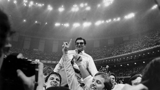 FILE - In this Jan. 1, 1983 file photo, Penn State head football coach Joe Paterno takes a victory ride from his players on the field at the Superdome after winning the Sugar Bowl and national championship in New Orleans. Penn State football coach Joe Paterno say he plans to retire at the end of the season, his long and illustrious career brought down because he failed to do all he could about an allegation of child sex abuse against a former assistant. (AP Photo/File)
