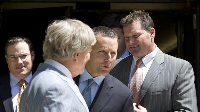 Former Major League Baseball pitcher Roger Clemens, right, and his attorneys Rusty Hardin, second left, and Michael Attanasio, center, leave federal court in Washington, Tuesday, April 24, 2012. Clemens' lawyer opened his defense of the former pitching star by telling jurors that evidence purportedly showing Clemens used steroids was manipulated by his former strength coach, Brian McNamee.    (AP Photo/Manuel Balce Ceneta)