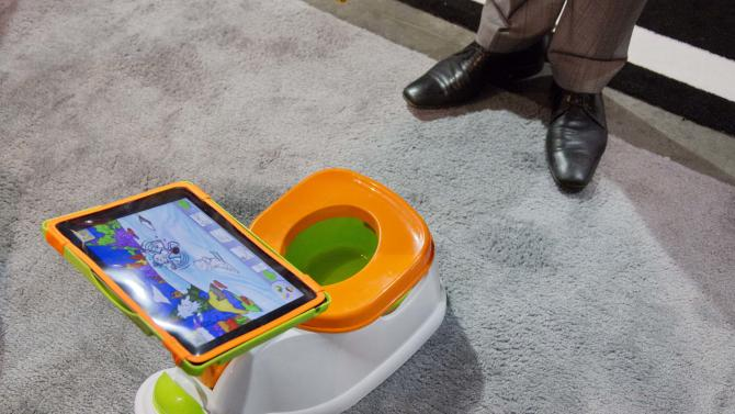 The iPotty for iPad potty training device is see on display at the Consumer Electronics Show, Wednesday, Jan. 9, 2013, in Las Vegas. No app is available to go with the trainer, but the idea is to keep the child on the toilet for as long as necessary by keeping them digitally entertained. (AP Photo/Julie Jacobson)