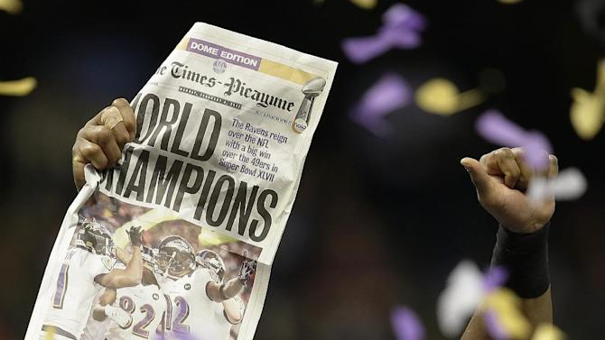 Baltimore Ravens linebacker Ray Lewis holds up a newspaper after defeating the San Francisco 49ers in the NFL Super Bowl XLVII football game, Sunday, Feb. 3, 2013, in New Orleans. The Ravens won 34-31. (AP Photo/Elaine Thompson)