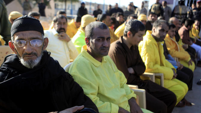 Iraqi detainees sit during a release ceremony held in the Iraqi Interior Ministry in Baghdad, Iraq, Monday, Jan. 14, 2013. Protesters in predominantly Sunni parts of Iraq have been demonstrating for more than three weeks against what they see as unfair treatment by the government against their sect. The release of detainees held without charges has been one of their main demands. (AP Photo/Karim Kadim)