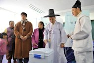South Korean Confucian scholar Yoo Bok-Yeob (2nd R) casts his vote in the presidential election at a polling station in Nonsan, on December 19, 2012. South Korea has elected its first female president, handing a slim but historic victory to conservative ruling party candidate Park Geun-Hye, daughter of the country's former military ruler