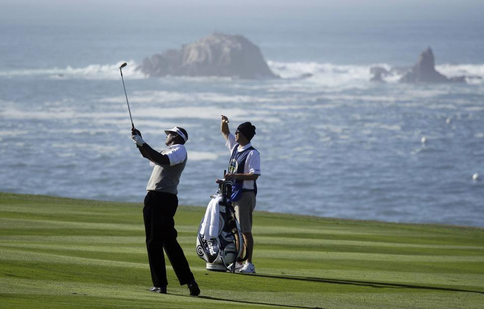 Vijay Singh, from Fiji, hits from the fourth fairway at Pebble Beach Golf Links during the first round of the AT&T Pebble Beach National Pro-Am golf tournament in Pebble Beach, Calif., Thursday, Feb. 9, 2012. (AP Photo/Eric Risberg)