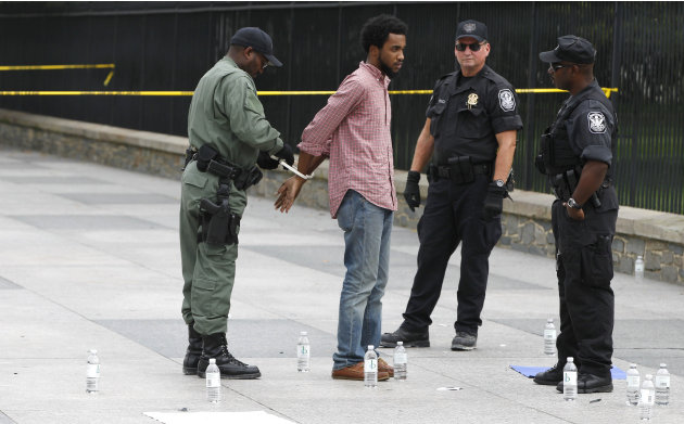 A demonstrator is arrested by U.S. Park Police officers in front of the White House in Washington,Wednesday, Sept. 21, 2011, protesting the planned execution of death row inmate Troy Davis. Davis is f