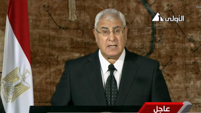 This image made from video broadcast on Egyptian state television show's Egypt's interim President Adly Mansour making his first address to the nation since taking his post after the ouster of Islamist President Mohammed Morsi, in Cairo, Egypt, Thursday, July 18, 2013. Egypt's interim leader vowed to protect the country from those who push for chaos and violence.(AP Photo/Egyptian State Television)