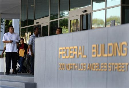 People arrive at the Federal Building, where the IRS offices are located, in Los Angeles