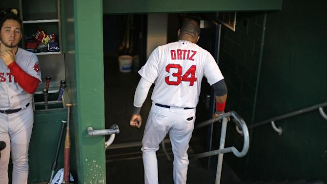 Boston Red Sox's David Ortiz (34) walks down the dugout steps to the locker room before a baseball game against the Pittsburgh Pirates in Pittsburgh Thursday, Sept. 18, 2014. The Pirates won 3-2. (AP Photo/Gene J. Puskar)