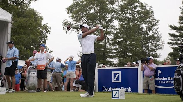 Tiger Woods of the U.S. tees off on the tenth hole during the second round of the Deutsche Bank Championship golf tournament in Norton, Massachusetts, August 31, 2013 (Reuters)