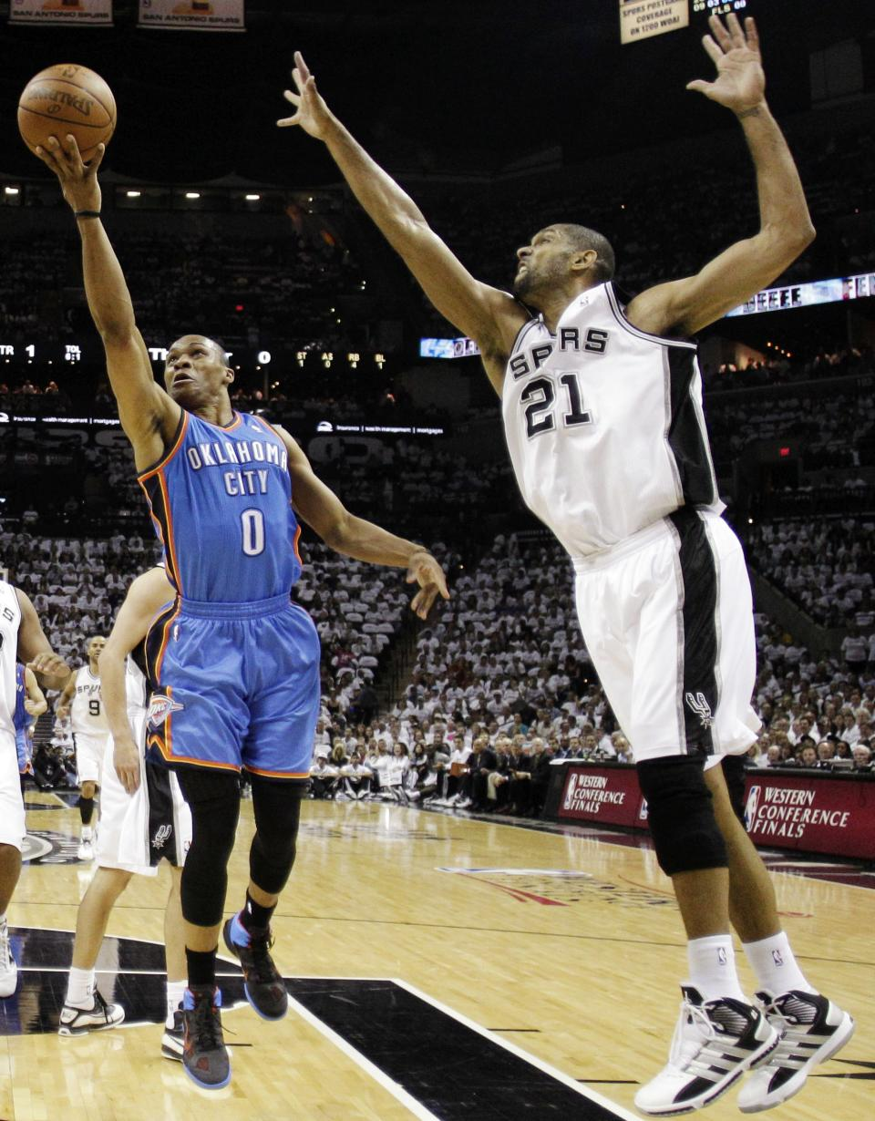 Oklahoma City Thunder point guard Russell Westbrook (0) shoots against San Antonio Spurs center Tim Duncan (21) during the first half of Game 5 in the NBA basketball Western Conference finals, Monday, June 4, 2012, in San Antonio. (AP Photo/Eric Gay)