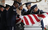 "CORRECTS DATE - Air Force servicemen remove the flag draped on the casket of actor Sherman Hemsley who was buried at the Fort Bliss National Cemetery with military honors, Wednesday, Nov. 21, 2012 in Fort Bliss, Texas. Friends and family remembered Hemsley at his funeral service in Texas by showing video clips of his best known role as George Jefferson on the TV sitcom ""The Jeffersons."" He died in July but a fight over his estate has delayed his burial. (AP Photo/The El Paso Times, Mark Lambie) EL DIARIO OUT; JUAREZ MEXICO OUT AND EL DIARIO DE EL PASO OUT"