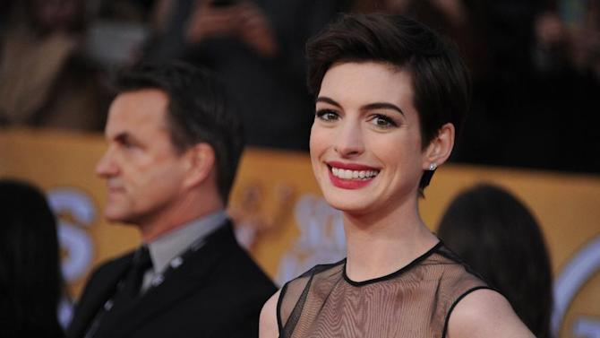 Actress Anne Hathaway arrives at the 19th Annual Screen Actors Guild Awards at the Shrine Auditorium in Los Angeles on Sunday Jan. 27, 2013. (Photo by Jordan Strauss/Invision/AP)