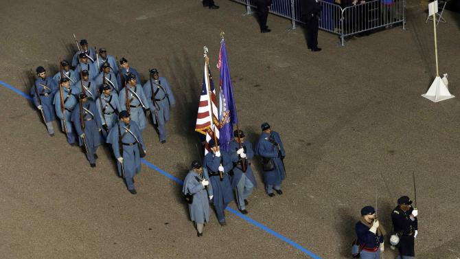 54th Massachusetts Volunteer Infantry Regiment, Company A, Massachusetts  perform while passing the presidential box and the White House during the Inaugural parade, Monday, Jan. 21, 2013, in Washington. Thousands  marched during the 57th Presidential Inauguration parade after the ceremonial swearing-in of President Barack Obama. (AP Photo/Charlie Neibergall)
