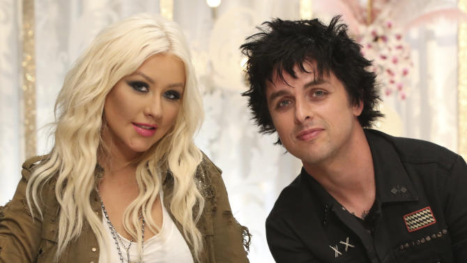"""In this Wednesday, July 25, 2012 publicity photo provided by NBCUniversal, Billie Joe Armstrong, right, sits with  Christina Aguilera.  Armstrong will join Aguilera as her team's mentor this season on NBC's , """"The Voice.""""  (AP Photo/NBCUniversal, Tyler Golden)"""