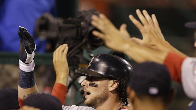 Boston Red Sox's Jarrod Saltalamacchia, center, celebrates in the dugout after a home run against the Los Angeles Angels during the second inning of an baseball in Anaheim, Calif., Tuesday, Aug. 28, 2012. (AP Photo/Chris Carlson)