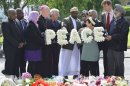 Local community representatives and faith leaders lay a floral tribute near the scene of the killing of British soldier Lee Rigby in Woolwich, southeast London