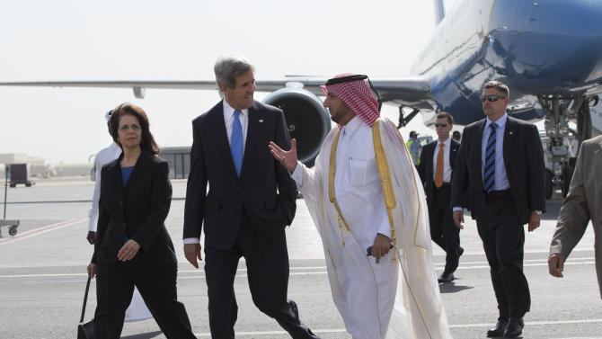 U.S. Ambassador to Qatar Susan Ziadeh, left, walks with U.S. Secretary of State John Kerry, second from left, and Ambassador Ibrahim Fakhroo, Qatari Chief of Protocol, on Kerry's arrival in Doha, Qatar, on Saturday, June 22, 2013. Kerry began the overseas trip plunging into two thorny foreign policy problems facing the Obama administration: unrelenting bloodshed in Syria and efforts to talk to the Taliban and find a political resolution to the war in Afghanistan. (AP Photo/Jacquelyn Martin, Pool)
