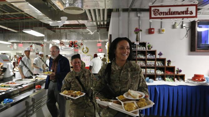 U.S. troops from the Nato-led International Security Assistance Force have lunch during Christmas celebrations at Bagram Airfield, north of Kabul