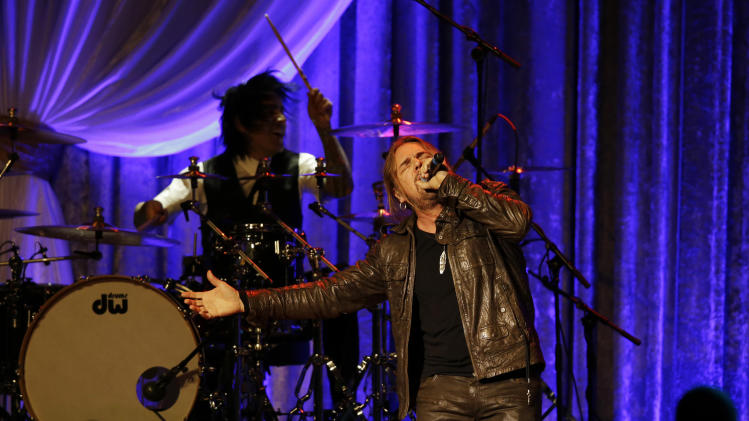 The Mexican pop rock band Maná performs during the Inaugural Ball at the 57th Presidential Inauguration in Washington, Monday, Jan. 21, 2013. (AP Photo/Paul Sancya)