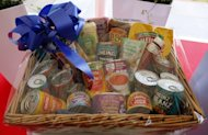 A hamper of Heinz products presented to Britain's Queen Elizabeth II and Prince Philip pictured during their visit to the Heinz food factory in Wigan, northern England, on May 21, 2009. Warren Buffett's investment powerhouse Berkshire Hathaway and 3G Capital announced Thursday that they would take over venerable US ketchup maker Heinz in a deal valuing the company at $28 billion