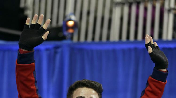 Max Aaron celebrates his score in the senior men's free skate program at the U.S. figure skating championships, Sunday, Jan. 27, 2013, in Omaha, Neb. (AP Photo/Charlie Neibergall)