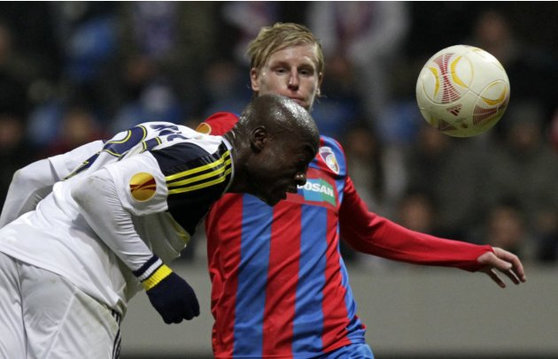Webo of Fenerbahce heads the ball ahead of Rajtoral of Viktoria Plzen during their Europa League match in Plzen