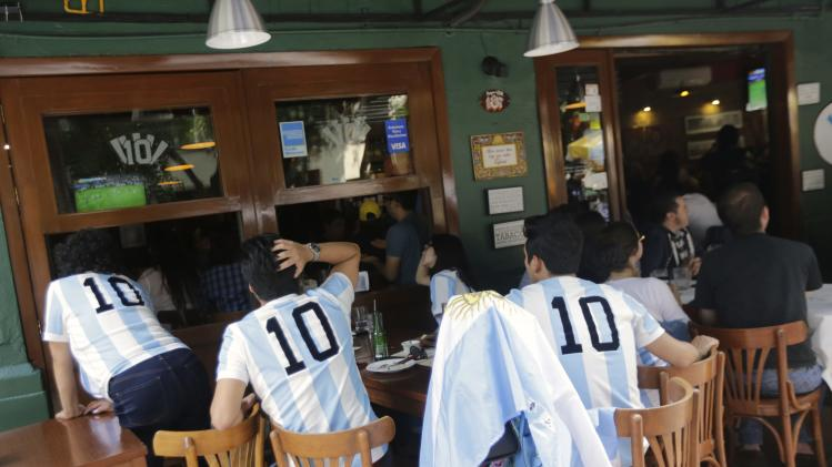 Fans of Argentina gather to watch the 2014 Brazil World Cup Final between Argentina and Germany, in a restaurant in Mexico City