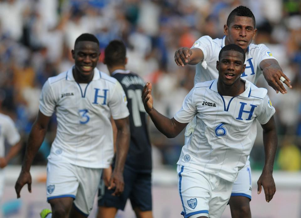 Honduras' Juan Carlos Garcia, front, celebrates followed by teammates after scoring U.S. during a 2014 World Cup qualifying soccer game in San Pedro Sula, Honduras, Wednesday Feb. 6, 2013. (AP Photo/Fernando Antonio)
