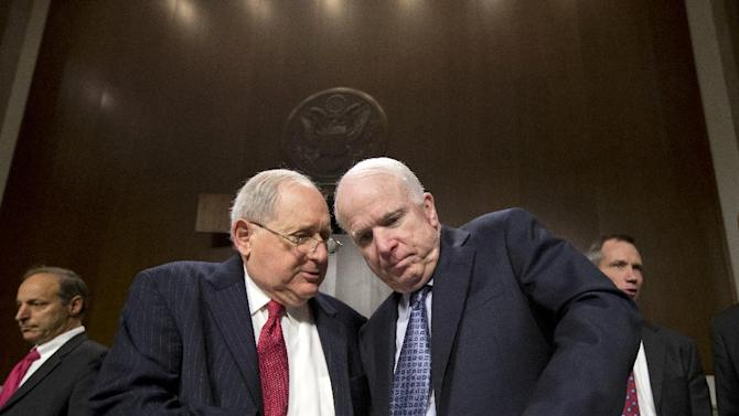 FILE – In this April 9, 2013, file photo Sen. Carl Levin, D-Mich., left, talks with Sen. John McCain, R-Ariz., on Capitol Hill in Washington. A Senate investigative panel led by Levin and McCain has been reviewing the use of the social welfare groups for political causes for the past year. The lawmakers had planned a hearing on the subject but postponed it following the Internal Revenue Service disclosure, so it could examine the agency's handling of the tax-exempt reviews. The IRS has endured withering criticism for its scrutiny of conservative political groups during the 2012 elections. (AP Photo/J. Scott Applewhite, File)