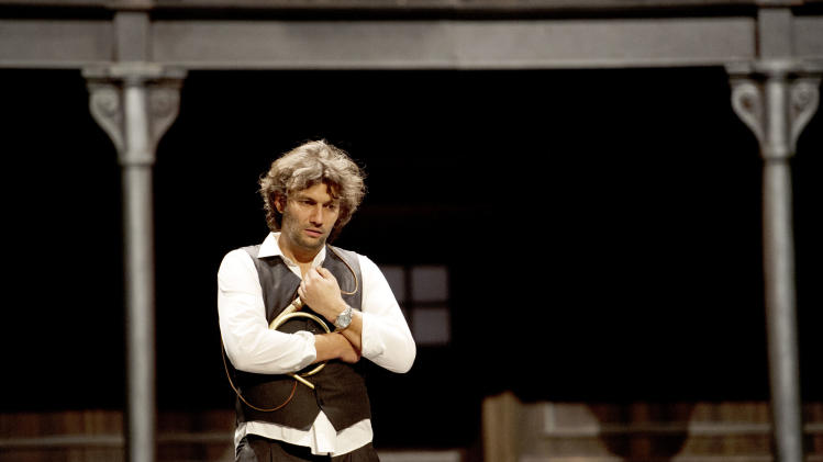 """In this undated photo provided by Alla Scala theater press office, Jonas Kaufmann, who plays Lohengrin, performs during rehersals of Richard Wagner's Lohengrin at the Milan La Scala opera house, Italy. The dual bicentennial of the births of composers Giuseppe Verdi and Richard Wagner is turning into a dueling bicentennial. La Scala general manager Stephane Lissner on Monday, Dec. 3, 2012 dismissed as """"ridiculous"""" criticism by the Italian media because the famed Milan opera house that was once Verdi's musical home is opening the celebratory season with Wagner's """"Lohengrin."""" No less than Italy's respected President Giorgio Napolitano entered the fray. He wrote a letter to musical director Daniel Barenboim rejecting press rumors that he was snubbing the gala season opener on Friday. (AP Photo/Monika Rittershaus, La Scala)"""