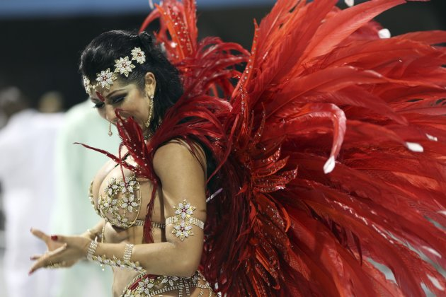 A reveller parades for the Camisa Verde e Branco Samba School during a carnival at the Anhembi Sambadrome in Sao Paulo