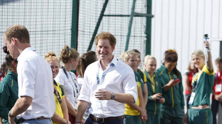 Britain's Prince William and Prince Harry meet players and staff before the Wales versus Scotland group B preliminary round of the womens hockey during the 2014 Commonwealth Games in Glasgow