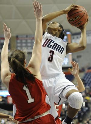 Connecticut's Tiffany Hayes, right, goes up for a basket while guarded by Hartford's Jackie Smith during the first half of an East Regional first-round NCAA women's college tournament basketball game in Storrs, Conn., Sunday, March 20, 2011. (AP Photo/Jessica Hill)
