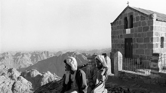 FILE - In this Nov. 13, 1979 file photo, Jebeiya Bedouin children take in the scenery at the summit of Mount Sinai, (7,500 feet) in the southern central sector of the Sinai Peninsula in Egypt. Egyptian security officials said Monday that they will not give in to the demands of a Bedouin man who took hostage two Americans and their local translator, now entering their fourth day in captivity. Boston-area residents Pentecostal Rev. Michel Louis, 61, and 39-year-old Lissa Alphonse were taken off a bus Friday with their Egyptian tour guide on a road in the Sinai Peninsula. The two Americans were on a Holy Land tour heading from Cairo to the sixth-century St. Catherine's Monastery, located at the foot of Mount Sinai where the Old Testament says Moses received the stone tablets with the Ten Commandments. (AP Photo, File)