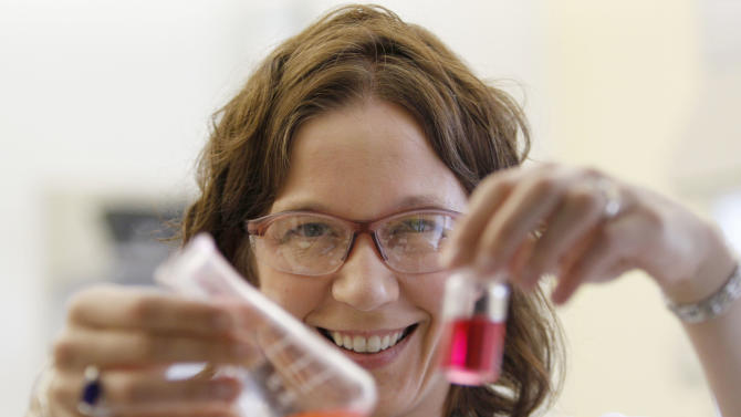 "In this Thursday, Sept. 15, 2011 photo, William & Mary professor Elizabeth Harbron displays vials with merocyanine and rhodamine dye in her lab in Williamsburg, Va. Though she was happy to help blaze a path, Habron says she didn't start out to create an all-women's lab. It happened naturally, with students seeking her out because they liked her informal, lively teaching style. With two-thirds of all undergraduate degrees and 60 percent of master's degrees now going to women, many believe it's only a matter of time before that trend influences the upper echelons of the ""STEM"" fields - science, technology, engineering and math. (AP Photo/Steve Helber)"