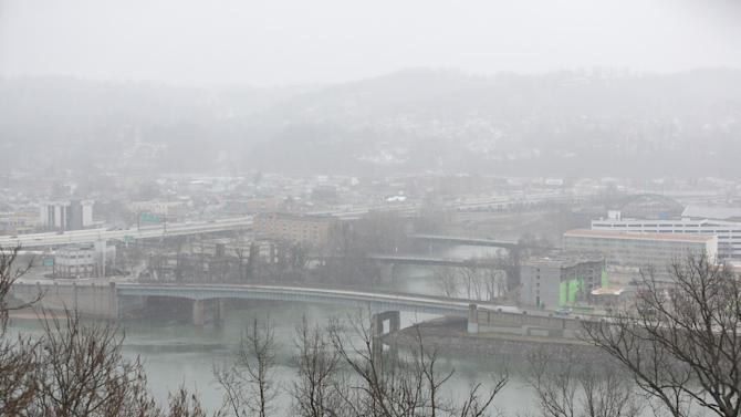 Snow falls over the confluence of the Elk and Kanawha Rivers, Sunday, March 16, 2014, in Charleston, W.Va. (AP Photo/Charleston Daily Mail, Marcus Constantino)