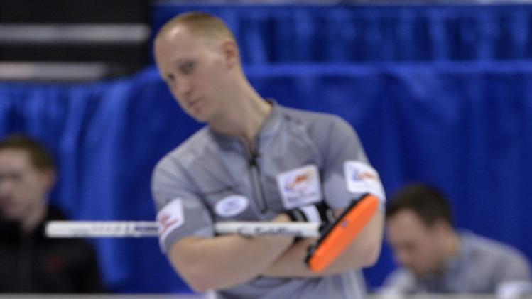 Skip Martin looks at the incoming shot as skip Jacobs looks on during the Roar of the Rings Canadian Olympic Curling Trials in Winnipeg