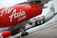 Budget carrier AirAsia's Philippine unit said Friday it had shelved planned daily flights to Macau amid a simmering maritime dispute between China and the Philippines