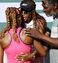 Serena Williams (L) is congradulated by her sister Venus and father Richard after defeating Kim Clijsters in the Tennis Masters Series final in Indian Wells, California, on March 17, 2001