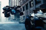 The Bat flying vehicle flies through Gotham's urban canyons in the Dark Knight Rises.