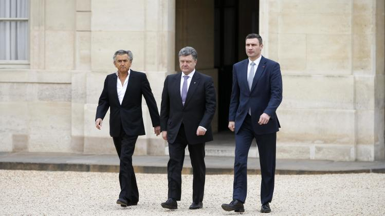 French philosopher Levy, Ukraine opposition leader Klitschko and Petro Poroshenko, a member of Ukraine's parliament, arrive at the Elysee Palace in Paris