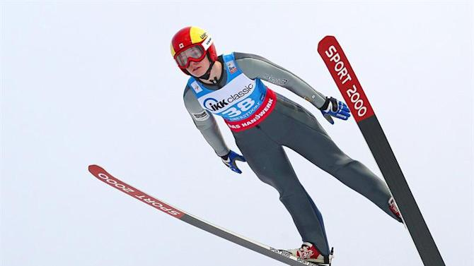AUG002. Oberstdorf (Germany), 25/01/2015.- Taylor Henrich from Canada in action during the Women's Ski Jumping World Cup in Oberstdorf, Bavaria, Germany, 25 January 2015. Henrich took the third place. (Alemania) EFE/EPA/KARL-JOSEF HILDENBRAND