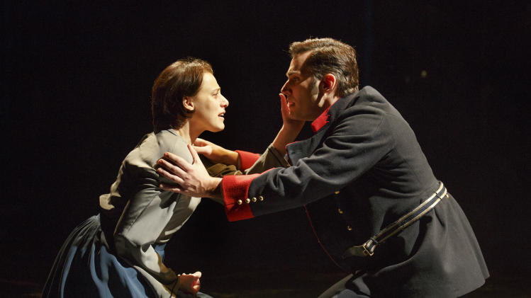 "This undated image released by The Publicity Office shows Judy Kuhn, left, and Ryan Silverman in a scene from the Stephen Sondheim-James Lapine musical, ""Passion,""  performing off-Broadway at Classic Stage Company in New York. (AP Photo/The Publicity Office, Joan Marcus)"