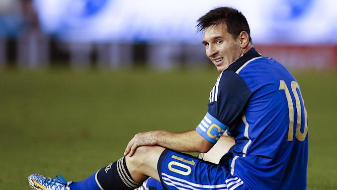 Argentina's Lionel Messi sits on the grass during an international friendly soccer match against Trinidad and Tobago in Buenos Aires, Argentina, Wednesday, June 4, 2014