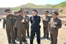 North Korean leader Kim Jong-un gives field guidance to the now under construction Breeding Station No. 621 of the Korean People's Army
