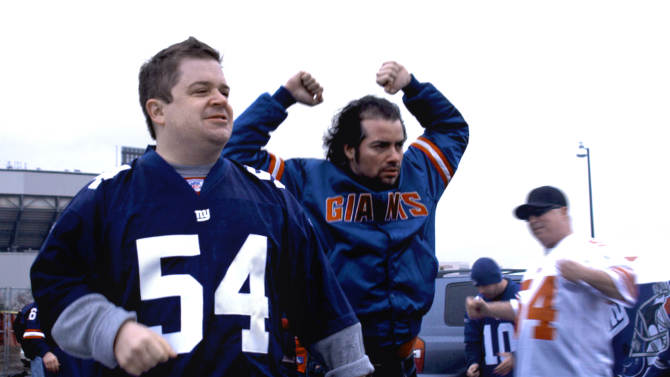 """In this film publicity image released by First Independent Pictures, Patton Oswalt, left, and Kevin Corrigan are shown in a scene from, """"Big Fan.""""  The 2009 film, written and directed by Robert D. Siegel (who also wrote """"The Wrestler""""), depicted a die-hard Giants fan (Patton Oswalt) whose devotion is tried when he's brutally assaulted by his favorite player. (AP Photo/First Independent Pictures, File)  NO SALES"""