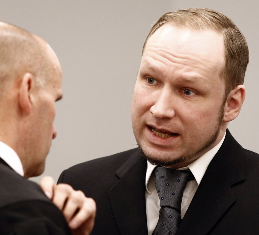 Defendant Anders Behring Breivik talks with defence lawyer Geir Lippestad, left, in court prior to the opening of day 6 of the trial in Oslo, Monday April 23, 2012. Breivik has admitted setting off a car bomb outside the government headquarters, killing eight, before unleashing a shooting massacre at the governing Labor Party's youth camp on Utoya. (AP Photo/Lise Aserud, POOL)